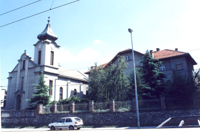 Požeška cerkev in hiša